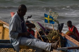 Gambia - Fisherman preparing catch