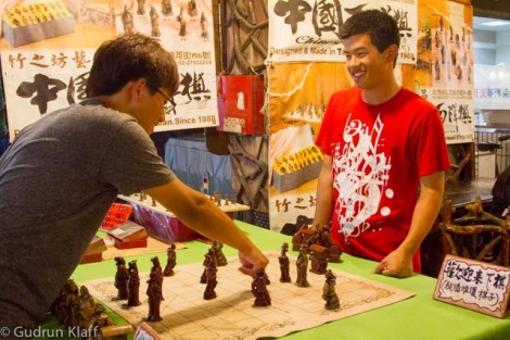 Chess players on the night market